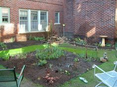 View from the back of the garden toward  the new rose bush and the rock pile (yet to be planted).