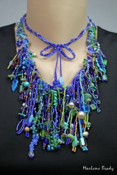 Marlene Brady. Fringe necklace with bow detail.  http://itsallaboutcreating.blogspot.com/search/label/Beadwork