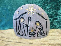A hand engraved, unique, natural stone Nativity Set to begin or add to your collection. Celebrate every Christmas, Joyously with this Holy Family ensemble.  4 inches tall 4.5 inches wide 3 inches deep. This is a light purple stone with white accents.  This listing is for ~1~ natural stone, engraved NATIVITY. It includes 1 glacier stone with -----Baby Jesus -----Joseph -----Mary  This river stone hales from the Snake River Valley in the Rocky Mountains of Idaho. It is just the right size to…