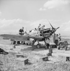 Ground crew servicing Supermarine Spitfire Mark VB, ER676 'HT-E', of No. 154 Squadron RAF in its dispersal at Souk el Khemis ('Victoria'), Tunisia. The aircraft failed to return from a mission escorting American B-25s to Tunis the following day.