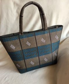 The Chika Bag - Available now for delivery. This bag also works great as a work bag- and just as awesome to use as a handbag. All our #teachers #doctors and all ladies who need a work bag that's true to your style, you must get one. Different colors/print available. $50 (plus s&h). #ankara style.
