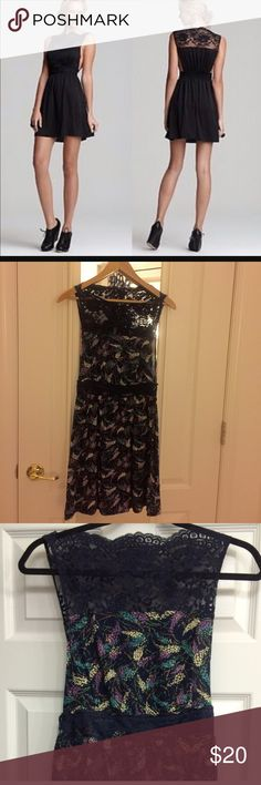 Free people dress Free people dress.  The dress is multi color design w navy blue background. The first pic is same dress but in black for fit reference. The dress is open down on the sides. Free People Dresses Mini