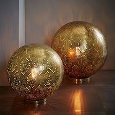 Moroccan Metal Orb Light #westelm.  Could look nice on a book shelf in the TV room.  Add a little light but not too much to interfere with movie night!