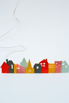 Cardboard cut-out village.