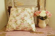 This sweet pillow is filled with beautiful pink roses.It has a vintage look to it,but appears to be newer.The background is a creamy white.I does not appear to have any stains or rips.This is in wonderful used condition.This would have to be spot cleaned it does not have a zipper opening.Perfect for your Romantic Country Home.Pillow measures 15x15. Price includes shipping to US only.At this time we do not ship to Alaska or Hawaii.