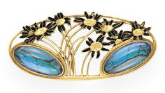 AN ART NOUVEAU MOONSTONE, ENAMEL AND GOLD BROOCH, BY RENE LALIQUE   The oval openwork plaque set with a cluster of gold and black enamel flowers with gold stems, enhanced by oval cabochon foil-backed moonstones, mounted in gold, circa 1900  Signed Lalique for René Lalique