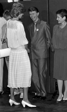 The Princess of Wales meets David Bowie at the Live Aid Concert. Standing on David's left,is Coco Schwab, his 'gal Friday'