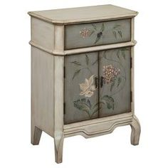 """Hand-painted floral cabinet with 1 drawer and 2 doors.  Product: CabinetConstruction Material: WoodColor: MultiFeatures: Hand-painted floral designDimensions: 32"""" H x 23.75"""" W x 13.75"""" D"""
