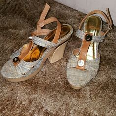 Gorgeous ladies multi-colored sandals. Platform heels accent with gold multicolor Brown peach blue and cream. Only worn once forgot I had them in my closet. Received many compliments off these sandals. Looks great with a pair of shorts or skirts. Bamboo Shoes Sandals