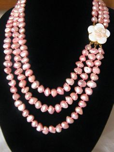 Pink Natural Baroque  Freshwater Pearl Three Strand Necklace With A Mother Of Pearl Flower Clasp