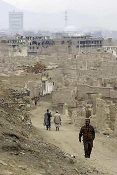 View from Balahissar Fort over the ruins of badly shelled villages towards Kabul, Afghanistan in February 2002. Balahissar Fort was one of t...