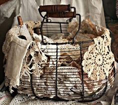 Wire basket with vintage doilies at Tattered Chick