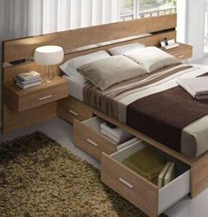 Looking for a way to live large in your small bedroom? The secret's in your storage solutions! We've rounded up 40 small bedroom storage ideas that'll Beds For Small Spaces, Small Space Bedroom, Small Bedroom Designs, Bedroom Bed Design, Bedroom Furniture Design, Bed Furniture, Home Bedroom, Bedroom Ideas, Master Bedroom