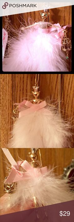 """Adorable Betsey Johnson necklace Brand new and never worn!!! This piece is so much fun and a fun addition to any outfit! Gold kitty studded with crystals and fur. She is carrying a tiny birdcage with an actual tiny bird! Sweet light pink bows accentuate her waist and cage. If the feathers are too much, you can rearrange and/or remove to suit your taste. Kitty also has legs that are under the feathers. Chain is approx 16"""" with a chain to give or take 3.5"""". Kitty measures 3.5"""" from her crown…"""