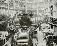 """Printemps Haussmann Paris - in 1905, Gustave Laguionie succeeds Jules Jaluzot, the creator of the Printemps. The architect René Binet rearranges the """"Anciens Magasins"""" (the actual Printemps Beauté Maison) and installs a four spiral staircase."""