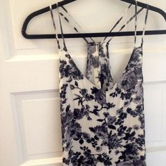 "Blue floral romper  This romper is so beautiful! It's good as new and very versatile! Size large but fits like a medium. Not actually free people. The tag says ""Timing"". Belt not included Free People Dresses"