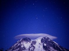 """""""A lenticular cloud over Mt. Rainier from August, viewed from a forest road southwest of the peak. The two bright stars are Castor and Pollux, of the Gemini constellation. Lenticular Clouds, Gemini Constellation, Castor And Pollux, Mount Rainier National Park, Forest Road, Adam And Eve, Bright Stars, Constellations, Cosmos"""