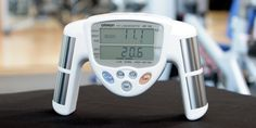 The Omron HBF-306C Fat Loss Monitor is a hand-held device that measures body-fat percentage and body mass index (BMI) using bioelectrical impedance. Users enter