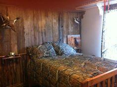 Old barn wood wall with fishing rod rack.