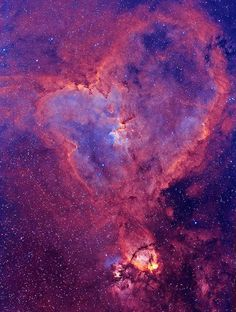 IC 1805: The Heart        Distance: 7,500 Light Years        Located in the Perseus arm of the Galaxy in the constellation Cassiopeia. This is an emission nebula showing glowing gas and darker dust lanes. The nebula is formed by plasma of ionized hydrogen and free electrons. The nebula's intense red output and its configuration are driven by the radiation emanating from a small group of stars near the nebula's