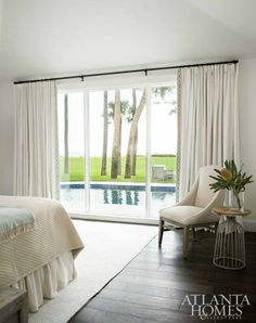 classic neutral bedroom, black curtain rod, dark timber floors