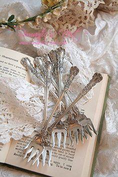 Rose sterling silver forks.