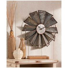 Metal Rustic Windmill Wall Clock Country Decor Inspired by a classic farm landmark Inspired by a classic farm landmark, this Metal Windmill Wall Clock is the perfect coordinating piece ...