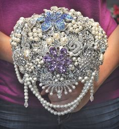 Blue Petyl's Cascading Brooch Bouquet :)  since you're allergic to flowers