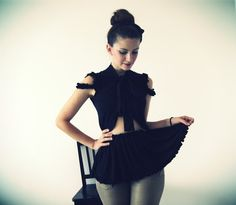 Black Fleurt Blouse With Peplum And Textured Shoulders