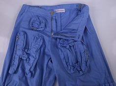 """: Walter Van Beirendonck. : This is an extremely nice pair of Walter Van Beirendonck """"HOPE"""" light blue cargo runway pants that look and feel incredible. They feature : Sky Blue. Patch Pocket : The pocket is sewn onto the exterior of the garment. 