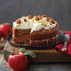 Apple-Pecan Carrot Cake | Top a showstopping crown of Mascarpone Frosting with swirls of Apple Cider Caramel Sauce and a scattering of salty-sweet Spiced Pecans. Caramel sauce, rather than fosting, sandwiches together the moist cake layers. | SouthernLiving.com