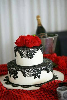 Black Lace and Red Roses Wedding Cake. The lace could possibly have pink lace on it instead of the black with a pink rose.