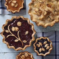 Cut shapes out of one crust and put them on another pie.    23 Ways To Make Your Pies More Beautiful