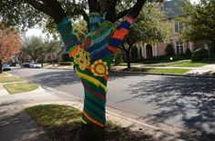 "A few weeks ago, University Park resident Jeff Brand was walking around the Bishop Arts District when he noticed something a little strange. An artist had ""yarn-bombed"" some of the trees in the neighborhood, wrapping their barky exteriors with warm, hand-knit tree sweaters. So he sought out the artist —K Witta— and commissioned a piece for his own yard, as a Valentine's Day present. University Park's Normandy Avenue has never been brighter."