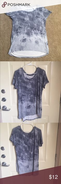 Tie-dye blouse This short sleeve oversized, tie-dye blouse is edgy and comfy! It would look great with cuffed skinnies and some combat boots!   It is a Tahari size XL and runs a little on the small side. Ideal fit for a size large!   All my items come from a smoke free and pet free home!   Tie-dye shirts, edgy fashion, spring clothes, comfy tops, flowy shirts, grey tops Tahari Tops Blouses