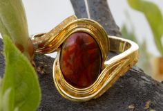 Custom Fire Agate ring set in 14Kt yellow gold with natural Alaskan gold nuggets.