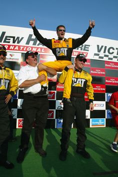 Holding up Ward Burton after a hard-fought victory at New Hampshire Motor Speedway.
