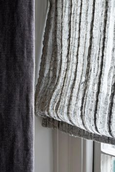The Phantom is a linen sheer by Bernie de Le Cuona and is made of stitched linen strips.