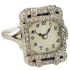 Rare ring watch platinum and 14k white gold, set with diamonds and sapphire