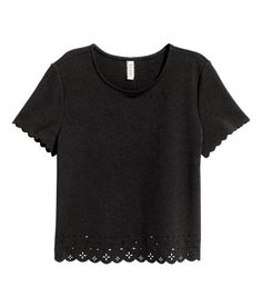 Check this out! Short-sleeved top in crêped jersey with a cut-out pattern at hem and scalloped trim at cuffs and hem. - Visit hm.com to see more.