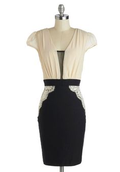 I love this dress...feminine details with a sleek silhouette
