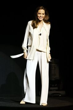 Angelina Jolie spoke on stage during the conference, wearing a Juan Carlos Obando cream blouse and wide-legged trousers with Salvatore Ferragamo heels.