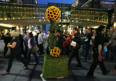 A person dressed as a Human Topiary walks across Main Street in Salt Lake City, Utah on March 23, 2012.