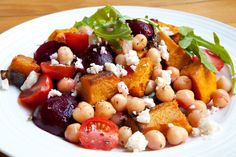 This healthy chickpea salad is the perfect side dish for dinner or as leftovers to take for lunch the next day. The flavours of the roasted pumpkin and beetroot really take this salad to the next level. This makes 1 serve. Ingredients:120g pumpkin, peeled and cut into 3 cm cubes3 tsp olive oilPinch of ground corianderPinch of ground cuminSalt and pepper, to taste2 small beetroot75g cooked chickpeas6 cherry tomatoes, cut in half¼ small red onion, finely sliced1 small handful of rocket…
