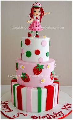 Strawberry Shortcake cake with doll on top of it