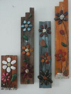 Composizione di quadri in legno e pietre naturali