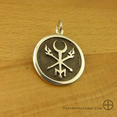 Hekate Phosphoros ~ A piece specific to Hekate Phosphoros- Hekate in her aspect as Light-Bringer and Torch-Bearer. The highly stylized Lunar Key has a trident shape for the 'teeth'. I envisioned this seal or sigil as a gate, an aid in passing through the liminal state and into the Dreaming and/or the Underworld. The Torches and Moon-Key form the Three Way Crossroads over which She rules.