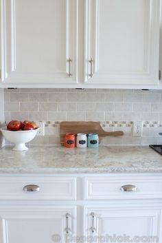 Add molding to cabinet doors, add backsplash,  and paint cabinets. by ivy