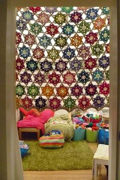 Flower In A Star, shown here as a pretty curtain. Free pattern by Sue Pinner, aka shropshirescrappersuz, at this link ~ http://shroshirescrappersuz.blogspot.com/2011/09/crochet-flower-in-starready-for.html#