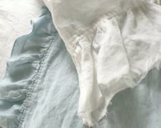This frayed ruffle pillowcase in pure linen fabric adds a soft romantic vintage style to any room. Flax fiber is soft to the touch and becomes even softer with each washing. This vintage washed linen Cream Bedding, Linen Bedding, Linen Fabric, Bed Linens, White Bedding, Luxury Duvet Covers, Luxury Bedding Sets, Modern Bedding, Luxury Linens